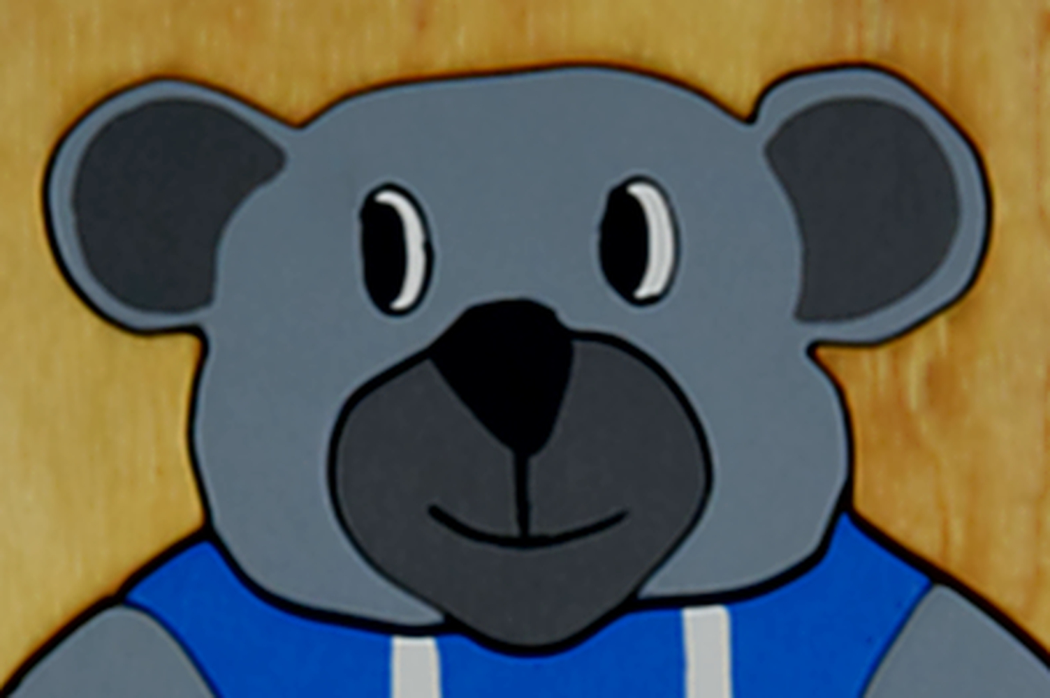 Holzpuzzle grauer Bär